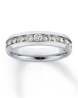 This stunning Now & Forever™ diamond anniversary band features 14 beautifully matched round diamonds in a channel setting, with a total diamond weight of one carat. A band of 14K white gold complements these diamonds. This fine jewelry band is Supreme-Fit™ for true comfort and durability. Available at select Kay Jewelers locations -- call 1-800-527-8029 for the store nearest you. Diamond Total Carat Weight may range from .95 - 1.11 carats.