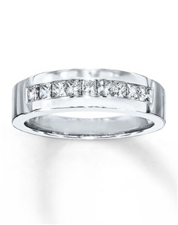 A row of square-cut diamonds is channel-set in a band of 10K white gold in this bold wedding band for him. The ring has a total diamond weight of 5/8 carat. Diamond Total Carat Weight may range from .58 - .68 carats.