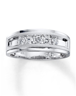 Five sparkling round diamonds are the center of attention in this handsome band for him. Crafted of 10K white gold, the ring has a total diamond weight of 1/2 carat. Diamond Total Carat Weight may range from .45 - .57 carats.