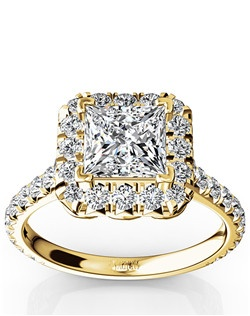 Intriguing princess halo micro pave set engagement ring set with 0.85 ct. tw. dazzling round side diamonds. Beautiful scroll wire work adds impressive finishing to this engagement ring. Your choice of center stone will be set V tip prongs. This ring is available in 14k, 18k, white gold, yellow gold, rose gold, platinum and palladium.