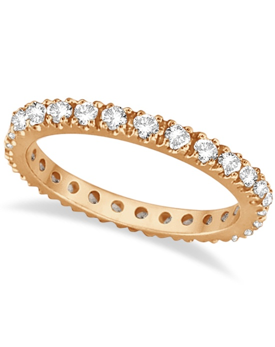 """27 brilliant-cut round diamonds are set in a sparkling prong setting and are circling all the way around this elegant 14k rose gold (pink gold) ring.