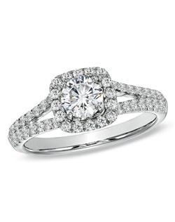Take her breath away with this absolutely stunning 1 ct. t.w. diamond engagement ring. Fashioned in 14K white gold, this exquisite ring showcases a magnificent 5/8 ct. certified Celebration Fire® diamond center stone, boasting a color rank of H-I and clarity of SI1-SI2. Master craftsmen cut 71 precise facets that create a pattern of ten hearts and ten arrows on every Celebration Fire® diamond. This exceptional diamond is surrounded by a frame of smaller round accent diamonds, which also line the ring's double split shank. This ring arrives with a certificate that includes a photo and a description of the diamond. The certificate guarantees quality and can be used for insurance purposes.