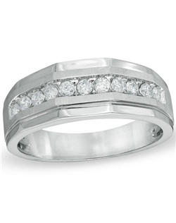 "An extraordinary gift for the man you love, this 10K white gold wedding band features a row of shimmering round diamonds showcased along a handsome angular band. Buffed to a brilliant luster, this amazing 1 ct. t.w. diamond style is the perfect way to exchange vows and say, ""I do."""