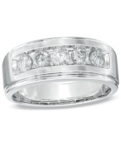 "Say ""I do"" in sophisticated style. Fashioned in 14K white gold, this handsome band for him features five shimmering diamonds, totaling 1 ct., aligned across the center. The sleek satin finish is a thoughtful touch. View product details."