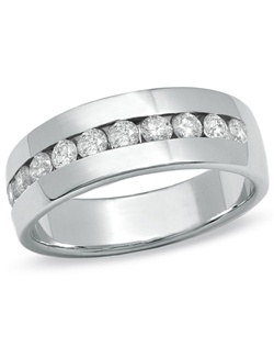 """An extraordinary gift for the man you love, this 14K white gold wedding band features a row of shimmering round diamonds showcased along a handsome channel setting. Buffed to a brilliant luster, this amazing 1 ct. t.w. diamond style is the perfect way to exchange vows and say, """"I do."""""""