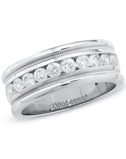 His smile, charm and good looks warm your heart. Surprise the love of your life with a 14K white gold diamond wedding band he will cherish and adore. Floating within an invisible-like setting, brilliant round diamonds totaling a stunning 1 ct. exude unmistakable shine. For an artful final touch, the edging is textured with a milgrain finish