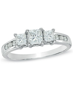 "Celebrate a lifetime of adoring love from the first moment you met to the cherished memories you are certain to create. Celebrate your ""ever after"" with a ring that says so much in so little words - past, present and future. Three sparkling princess-cut diamonds in a 4-prong setting symbolize your past, your present and your future together. Six round channel-set diamonds complement the centerpiece, bringing its total weight to 1 ct. Engraved inside the 14K white gold band and set with two accent diamonds are the words ""Past*Present*Future,"" reminding her of your promise to be by her side, always. View product details."