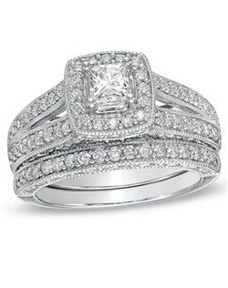 Ask for her hand with the elegant diamond ring, and seal your commitment with an equally beautiful wedding band. With diamonds totaling 1-1/4 cts., she'll fall in love with this stunning 14K white gold style. On her engagement ring, a precious 1/2 ct. princess-cut diamond shines. This gleaming center is bordered by a round diamond-embellished squared frame at the center of a split shank, also lined with diamonds. Glamorous and classic, complete the ensemble on your wedding day by adding the coordinating diamond-lined wedding band. View product details.
