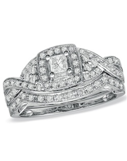 """An elegant """"twist"""" on tradition, this unique bridal set will win her heart - and her hand. Exquisite in 14K white gold, the engagement ring features a sparkling 1/5 ct. princess-cut center stone sparkling brightly. The ring's shank, and the coordinating wedding band, together form a twisted design and are micro-set with additional sparkling round diamonds, bringing the total to a breath-taking 1/2 ct. When you ask for her hand, do it with this sparkling bridal set!"""