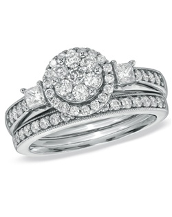 On that special day, when you ask for a lifetime commitment, WOW her with this magnificent bridal set. So lovely in 10K white gold, the engagement ring features a stunning flower-shaped cluster of round diamonds surrounded by a frame of smaller round accent diamonds. Princess-cut diamonds flank this center arrangement, while round accent diamonds line the polished, milgrain-edged shank. On your wedding day, complete the ensemble with the coordinating wedding band, also lined in glittering diamonds. Boasting a thoughtful 1 ct. t.w. of diamonds and a bright polished finish, this exquisite bridal set will endure for a lifetime of love.
