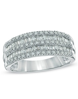Whether it's your first or fiftieth, honor the woman you love with this exquisite anniversary band. Beautifully crafted in 10K white gold, this ring is set with alternating rows of shimmering round and brilliant baguette-cut that create an eye-catching design. This charming ring sparkles with 1/2 ct. t.w. of diamonds and a bright polished shine.