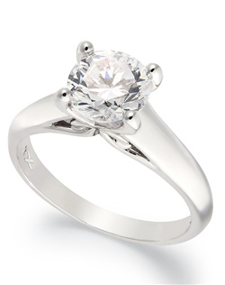 3/4cttw diamond engagement ring, certified, round-cut diamond  in a  18k white gold setting.