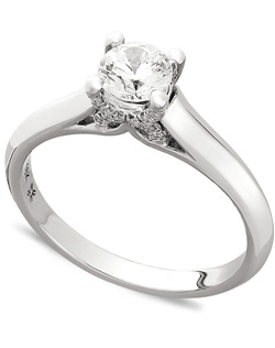 1/2cttw diamond engagement ring, certified, round-cut diamond  in a  18k white gold setting with diamond accent in the x-shape on the side