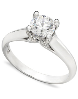 3/4cttw diamond engagement ring, certified, round-cut diamond  in a  18k white gold setting with diamond accent in the x-shape on the side