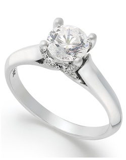 1cttw diamond engagement ring, certified, round-cut diamond  in a  18k white gold setting with diamond accent in the x-shape on the side