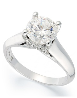 1 1/2cttw diamond engagement ring, certified, round-cut diamond  in a  18k white gold setting with diamond accent in the x-shape on the side
