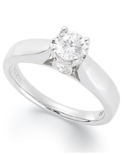 3/4cttw engagement ring, round-cut diamond with a  bezel-set diamond in the side of the band  in 14k white gold