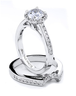 Bold and beautiful describes this engagement ring set designed by TRUE KNOTS® for the TRUE WOMAN® Engagement Ring Collection. Sparkling with 0.64tcw of diamonds and available in platinum and gold.
