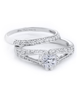 Bold and beautiful describes this engagement ring set designed by TRUE KNOTS® for the TRUE WOMAN® Engagement Ring Collection. Sparkling with 0.66tcw of diamonds and available in platinum and gold.