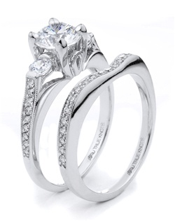 Bold and beautiful describes this engagement ring set designed by TRUE KNOTS® for the TRUE WOMAN® Engagement Ring Collection. Sparkling with 0.50tcw of diamonds and available in platinum and gold.