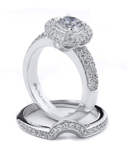 Bold and beautiful describes this engagement ring set designed by TRUE KNOTS® for the TRUE WOMAN® Engagement Ring Collection. Sparkling with 1.27tcw of diamonds and available in platinum and gold.