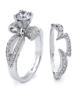 Reminiscent of sheer elegance, this Knot engagement ring designed by TRUE KNOTS® for The Knot Collection is sensual and inspired by the warmth of an embrace. Sparkling with 0.72tcw of diamonds, this engagement ring is sure to win her heart. Ring can accommodate any size round center (center not included). Available in platinum and gold.