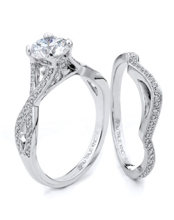 Reminiscent of sheer elegance, this Knot engagement ring designed by TRUE KNOTS® for The Knot Collection is sensual and inspired by the warmth of an embrace. Sparkling with 0.32tcw of diamonds, this engagement ring is sure to win her heart. Ring can accommodate any size round center (center not included). Available in platinum and gold.