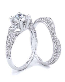 Reminiscent of sheer femininity, this Knot engagement ring designed by TRUE KNOTS® for The Knot Collection is sensual and inspired by the warmth of an embrace. Sparkling with 1.49tcw of diamonds, this engagement ring is sure to win her heart. Ring can accommodate any size round center. (center not included). Available in platinum and gold.