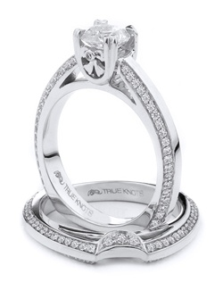 Reminiscent of sheer femininity, this Knot engagement ring designed by TRUE KNOTS® for The Knot Collection is sensual and inspired by the warmth of an embrace. Sparkling with 0.70cw of diamonds, this engagement ring is sure to win her heart. Ring can accommodate any size round center. (center not included). Available in platinum and gold.