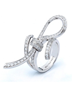 Reminiscent of sheer romance, originality and fun. This anniversary ring designed by TRUE KNOTS® for The Knot Collection is sensual and inspired by the warmth of an embrace. Sparkling with 1.40tcw of diamonds, this engagement ring is sure to win her heart. Available in platinum and gold.
