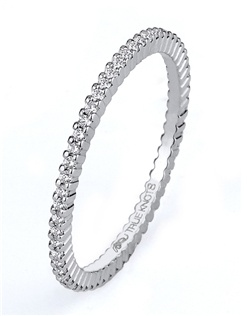 Steeped in tradition and designed to emanate the warmth, the sparkle and the light of diamonds in a pave set bridal jewelry collection. Featured is a dainty 14K white gold eternity band sparkling with 0.23tcw of  round diamonds. All from the Love is Light collection. Available in platinum and gold.