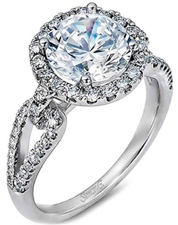 This beautiful 18k white gold engagement ring setting by Simon G features pave-set diamonds surrounding your choice of a center diamond as well as on the open design of the band.