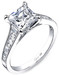 This diamond engagement ring setting by Sylvie features graduated baguette diamonds channel set along the shank leading up to the center stone of your choice.