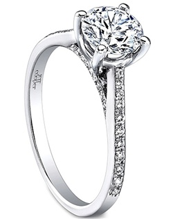 This diamond engagement ring setting by Jeff Cooper features round brilliant cut diamonds pave set along the shank to beautifully compliment your choice of center diamond.