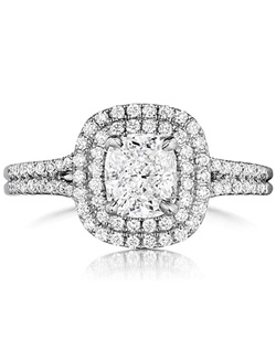 This diamond engagement ring setting by Henri Daussi features a double halo around the center stone of your choice on a split shank pave set with round brilliant cut diamonds.