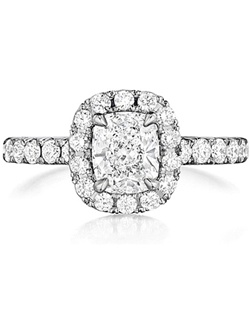 This diamond engagement ring setting by Henri Daussi features round brilliant cut diamonds pave set along the shank as well as around the center stone of your choice.