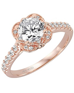 This diamond engagement ring setting by Art Carved features prong set round brilliant cut diamonds down the shank as well as in a floral pattern around the center stone of your choice.