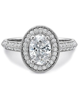 This flush fit diamond ring by Precision Set features two rows of pave set round brilliant cut diamonds down the shank as well as round brilliant cut diamonds around the center stone of your choice with a milgrain design along the edges.