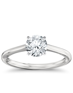 Elegant in its simplicity, this petite solitaire crafted in platinum is a beautifully classic frame for your choice of center diamond. Price listed below is for the setting only.