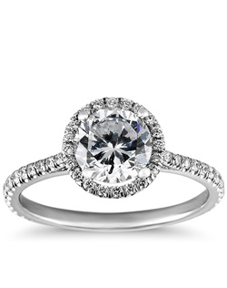 An elegant creation, this diamond engagement ring in 14k white gold showcases a thin line of micropavé-set diamonds that encircle your center diamond. Setting includes 1/4 carat total diamond weight. Price listed below is for the setting only.
