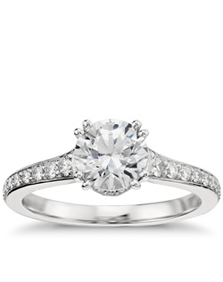 Capture your lasting love with this stunning platinum double-prong engagement ring that showcases an elegant drape of pavé-set diamonds around your center stone, along the subtly tapered shank, and inside the gallery for a captivating look. Price listed below is for the setting only.