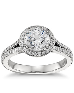 Capture your lasting love with this timeless platinum halo engagement ring that showcases an elegant drape of pavé-set diamonds along a split shank and around your choice of center stone. Price listed below is for the setting only.