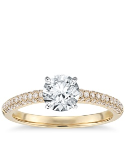 Stunning and intricate, this diamond engagement ring features intricately micropavé set diamonds on three sides of this 18k yellow gold ring design. Price listed below is for the setting only.