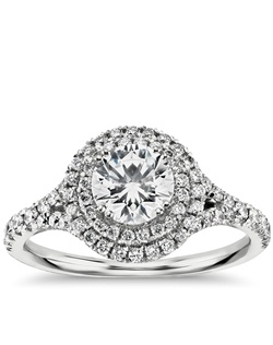 Capture the moment with this 18k white gold engagement ring, featuring pavé-set diamonds arranged in a double halo design and your choice of center diamond. Price listed below is for the setting only.