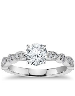 Vintage-inpired, this diamond engagement ring is crafted in 14k white gold and features petite diamonds set in a marquise and dot pattern with milgrain edges to frame your center diamond. Setting includes 1/5 carat total diamond weight. Price listed below is for the setting only.