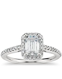Delicate in design, this diamond engagement ring showcases micropavé-set diamonds to frame the emerald cut diamond of your choice set in enduring platinum. Price listed below is for the setting only.