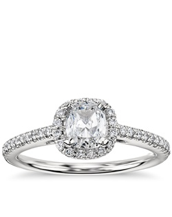 Delicate in design, this diamond engagement ring showcases micropavé-set diamonds to frame the cushion cut diamond of your choice set in enduring platinum. Price listed below is for the setting only.