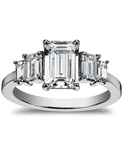 Elegance defined, this diamond engagement ring showcases four graduated, emerald-cut diamonds set in enduring platinum. Each side diamond is ideally matched in cut, clarity, and color to complement your choice of center diamond. Price listed below is for the setting only.