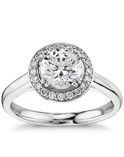 Capture your lasting love with this timeless platinum engagement ring that showcases an elegant halo of pavé-set diamonds and your choice of center stone. Price listed below is for the setting only.