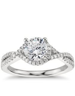 Capture your lasting love with this stunning platinum engagement ring that showcases an elegant drape of pavé-set diamonds around your center stone and along the twisting shank for a captivating look. Price listed below is for the setting only.